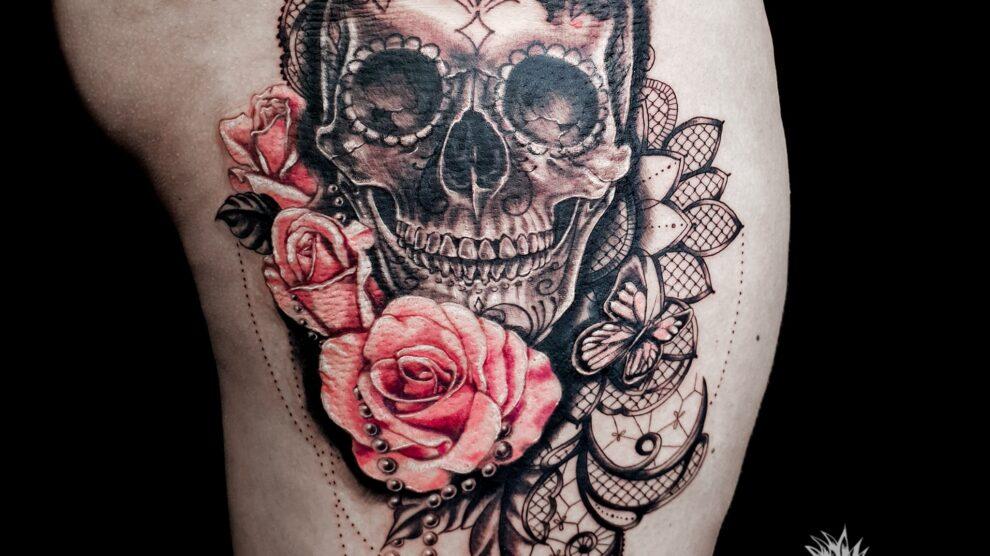 Skull and flowers tattoo